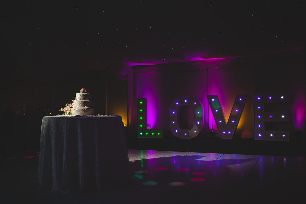 a love sign and a wedding cake