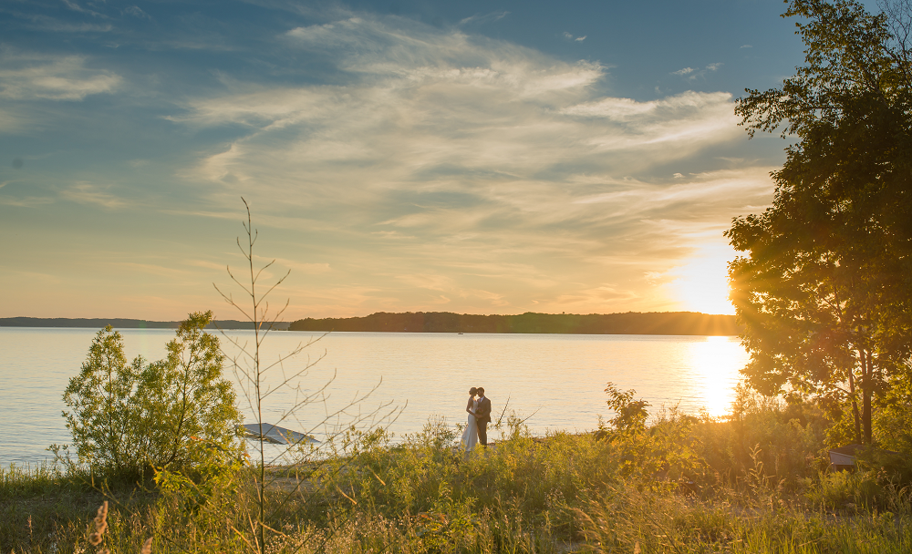 DESTINATION WEDDING IN TRAVERSE CITY WITH KRISTEN AND SCOTT Bride and Groom Sunset