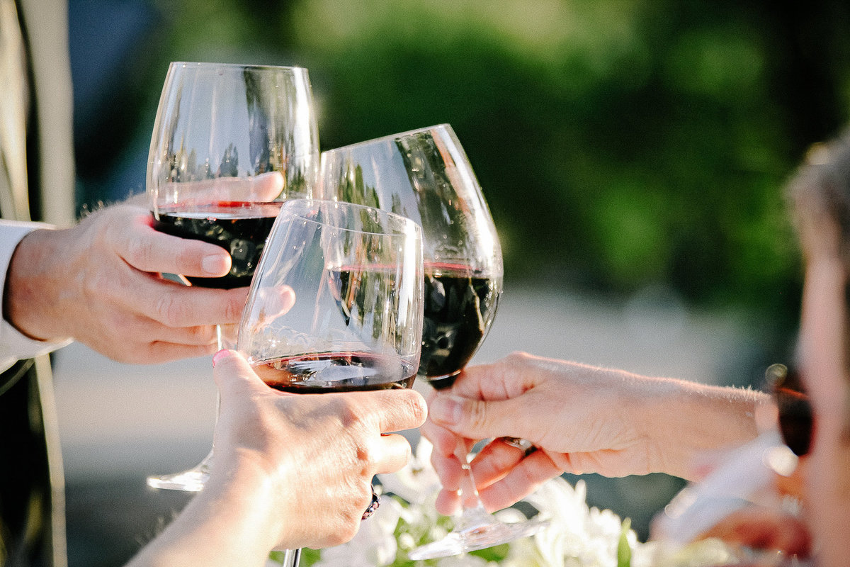 A wedding toast with red wine from Maroon Winery in Napa.