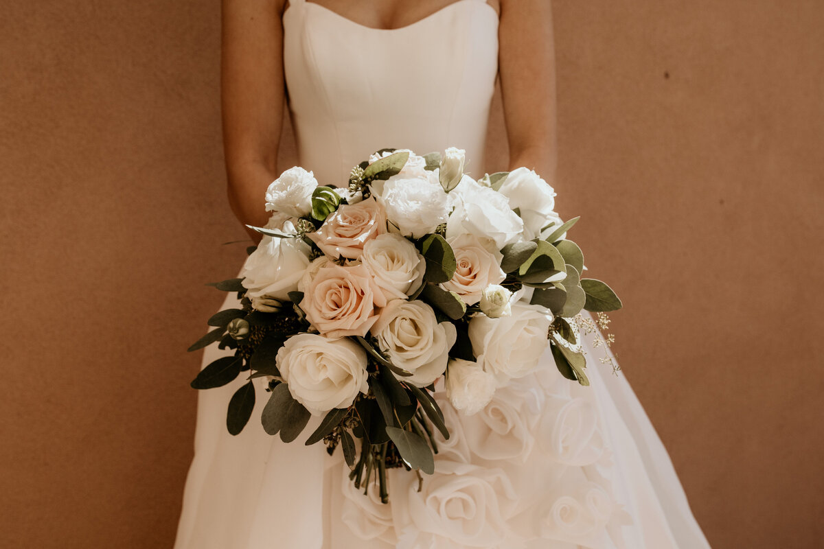 bride holding blush and white bouquet