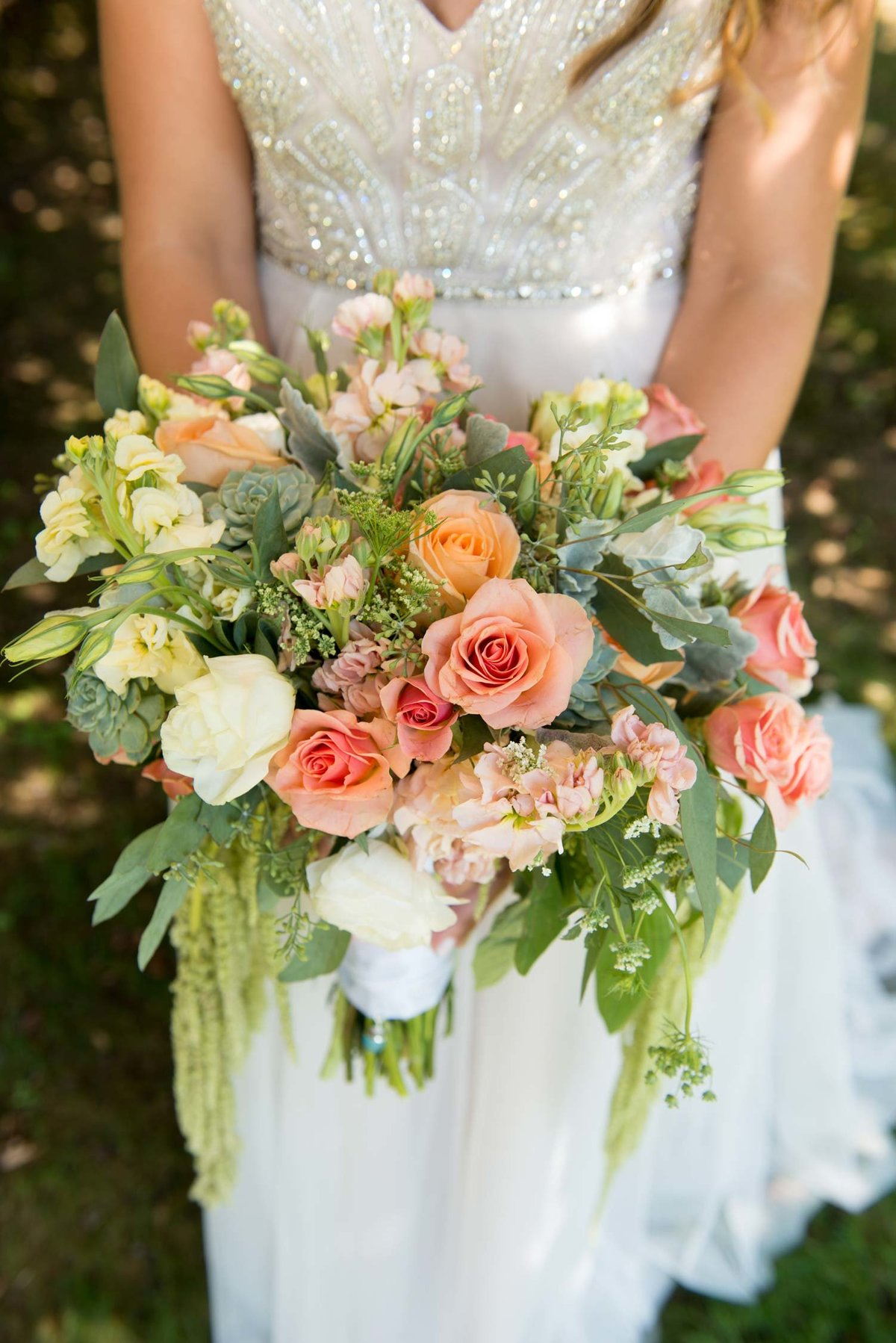 Bride's dress and bouquet at Flowerfield