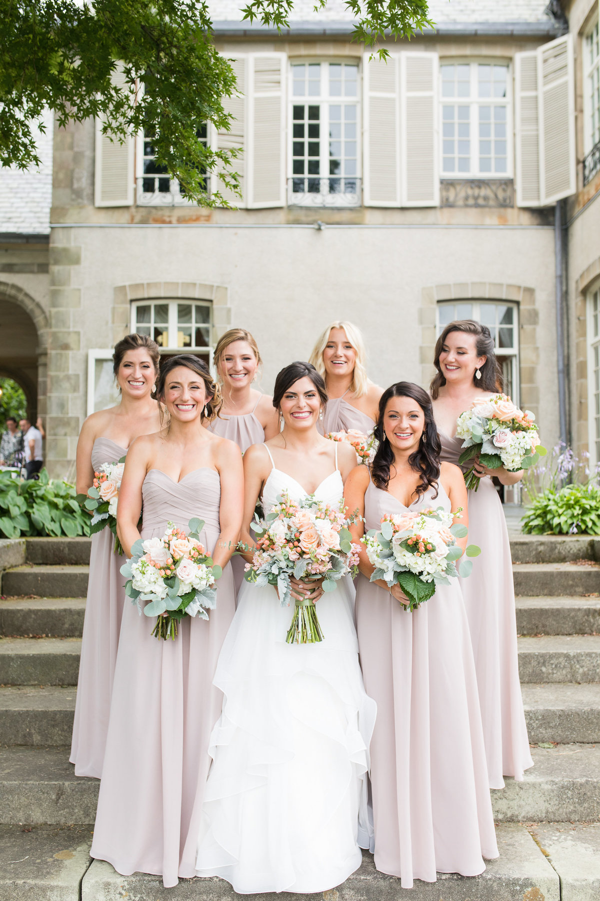 Portraits of the bridesmaids on the steps of Glen Manor House