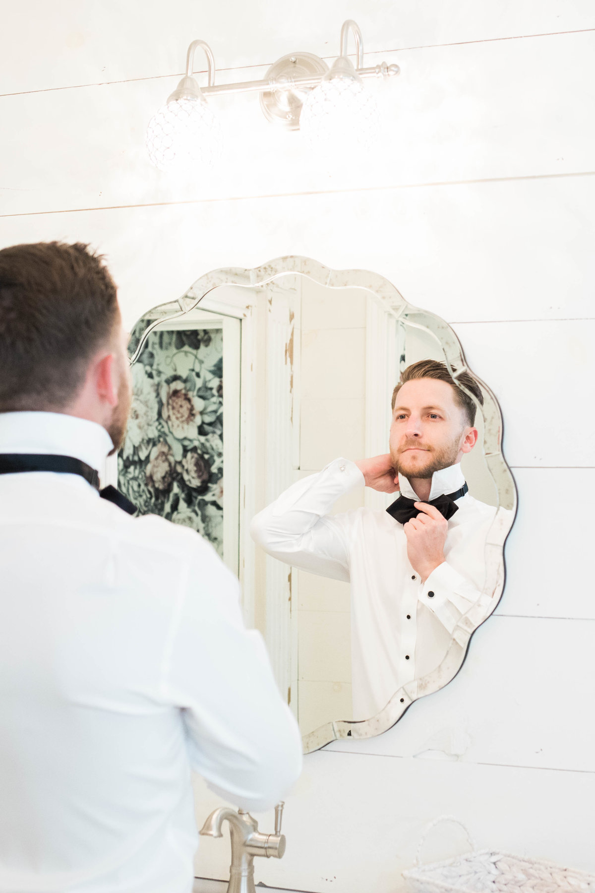 Groom Getting Ready by St Augustine Wedding Photographer