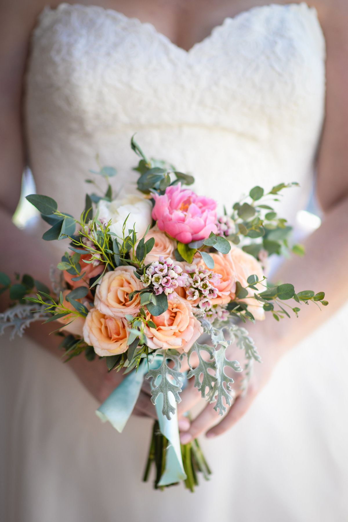 Beautiful NOLA Wedding Photography: Brides bouquet with pink, peach and green by Leaf + Petal at Race & Religious