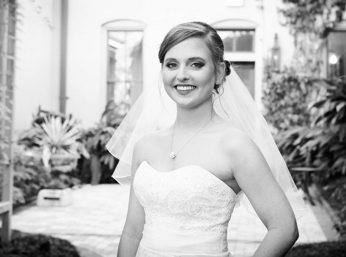 closeup of bride in the courtyard at The Southern Hotel