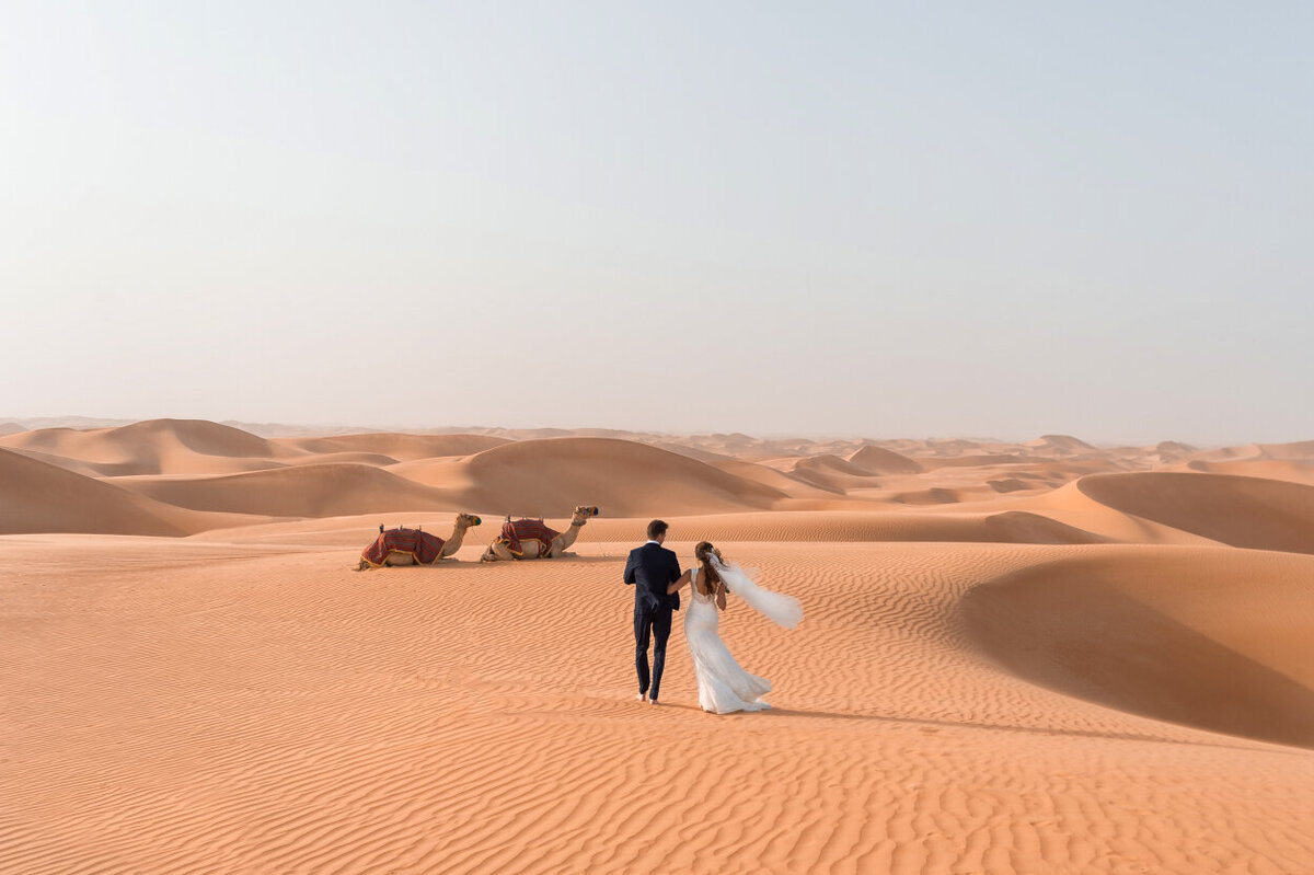 Desert Elopement photoshoot amidst endless dunes in Dubai at the Arabian Nights Village organized by Lovely & Planned
