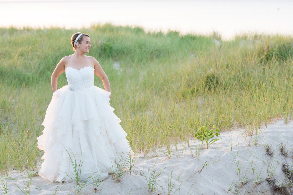 bride walking on the beach from wedding at Pavilion at Sunken Meadow