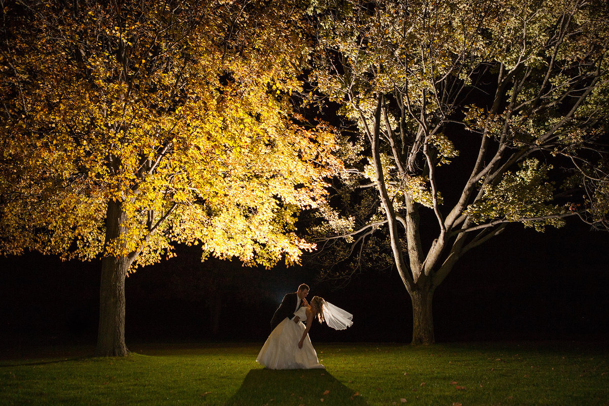bride and groom fall wedding atMauh-Nah-Tee-See Country Club in rockford illinois