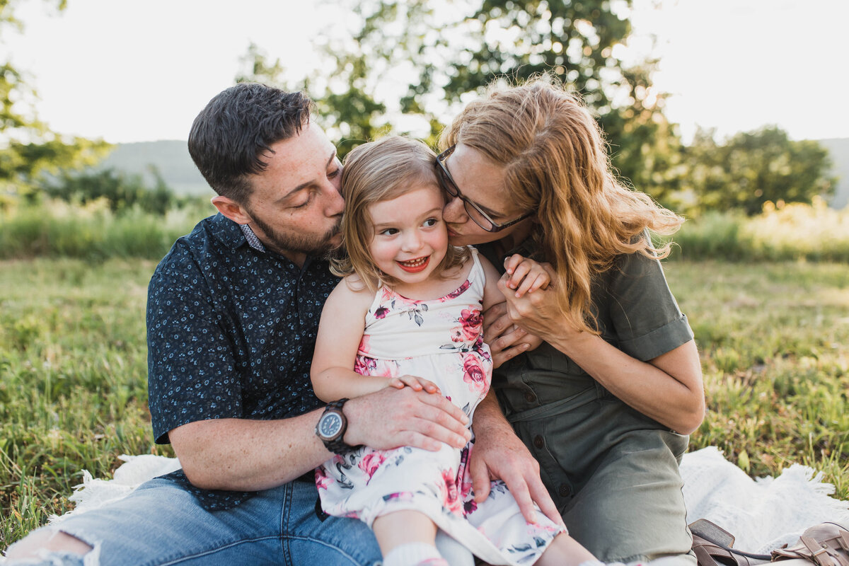 Oneonta Family photography, mom and dad kissing little girls' cheeks