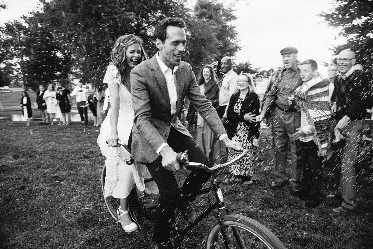epic wedding entrance on a bicycle made for two