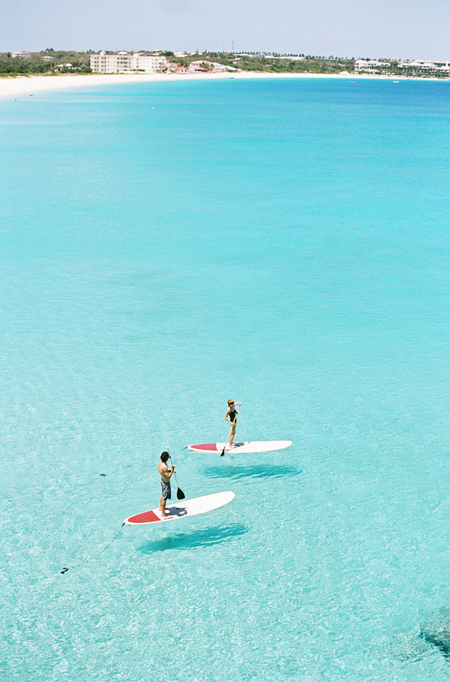 couple stand up paddleboarding at malliouhana