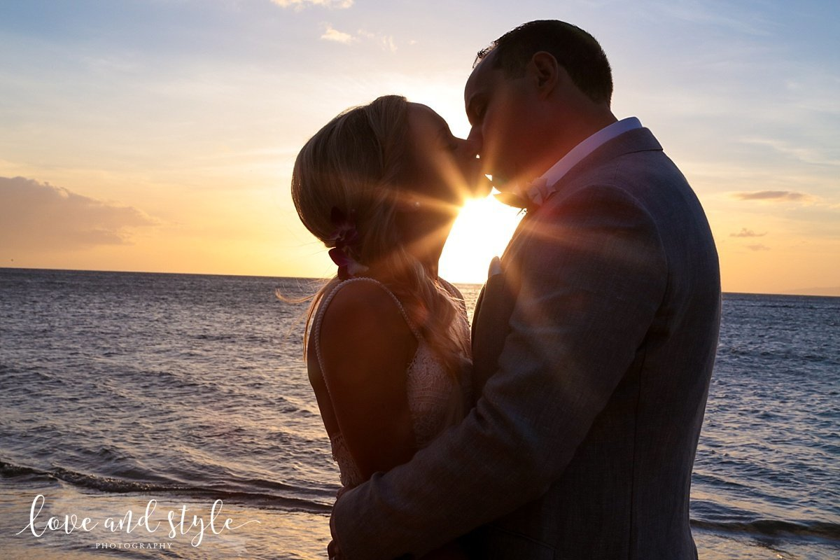 Anna Maria Island Wedding Photography of Couple kissing on the beach with the sunset