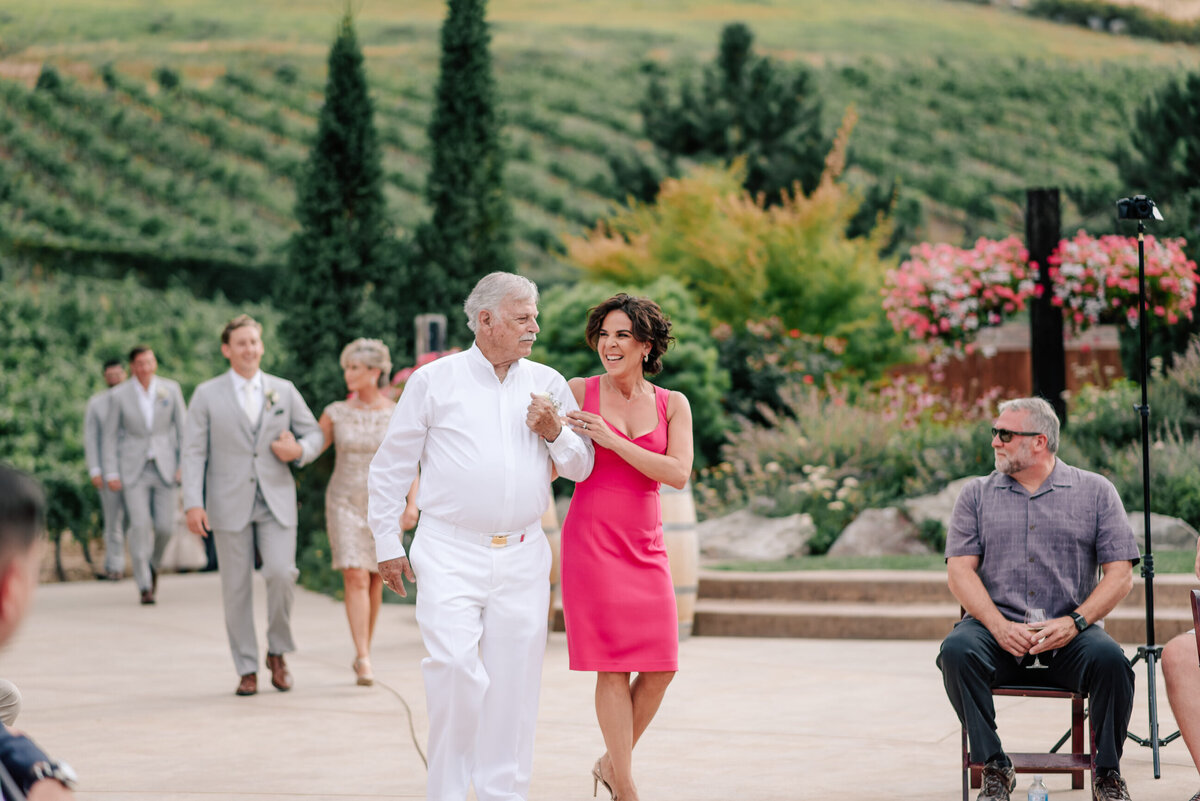 Bride's mother and grandfather walking down the aisle at Karma Vineyards wedding ceremony in Chelan, WA