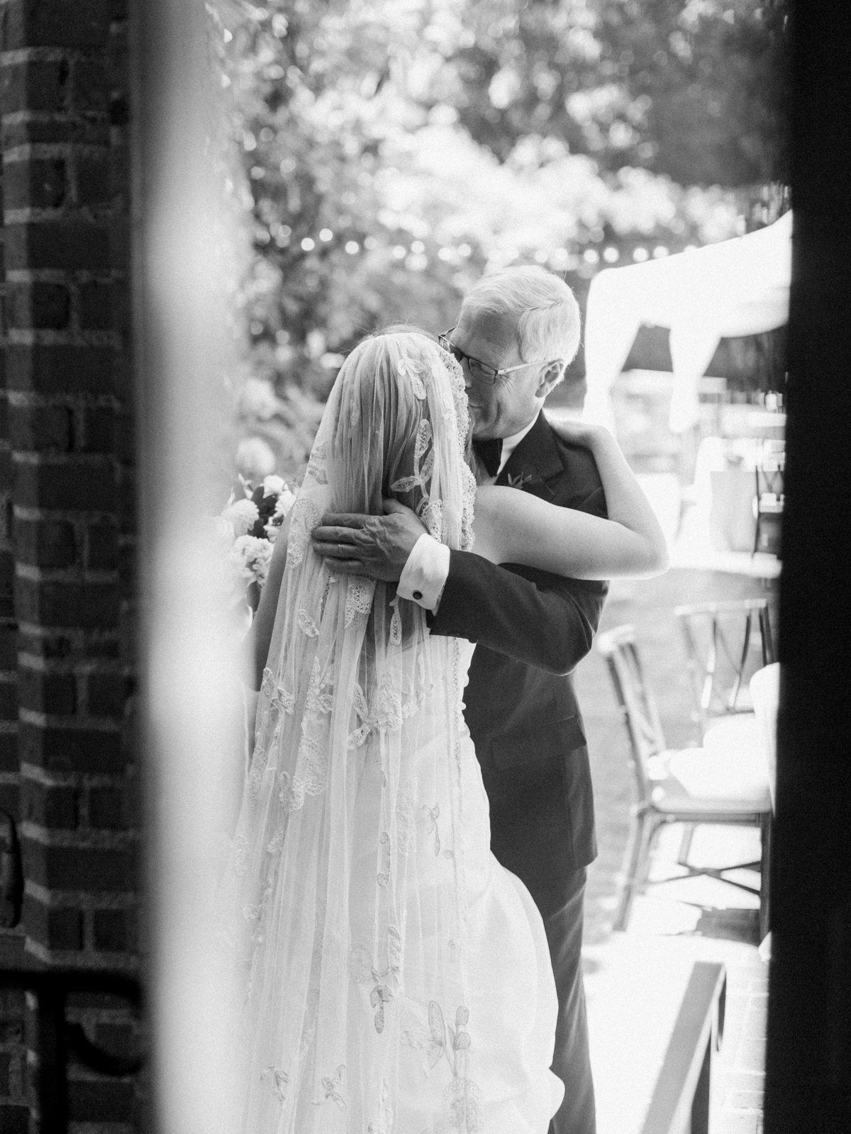 a bride hugging her dad