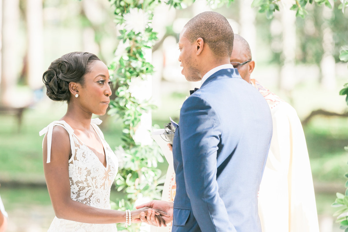 Bride and groom exchanging vows at Barbados destination wedding