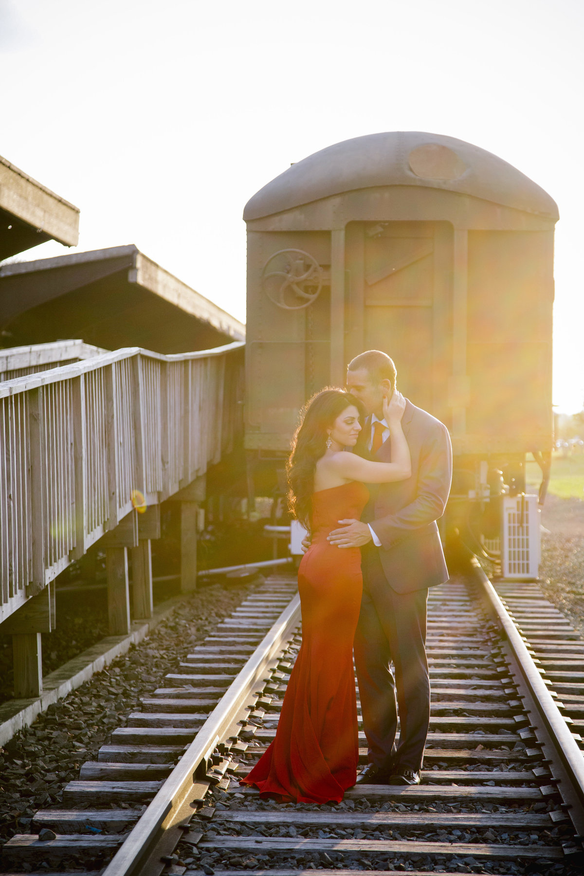 engaged couple by train at liberty state park