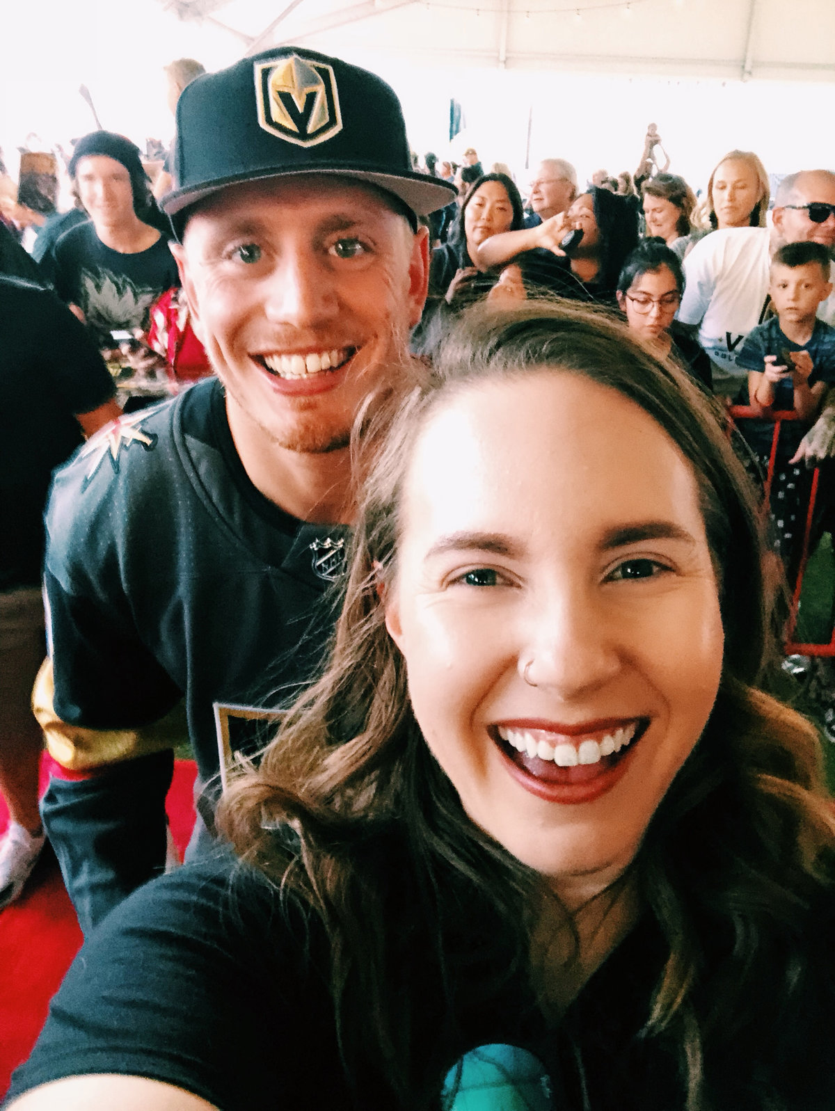 Fan poses with Nate Schmidt of the Vegas Golden Knights
