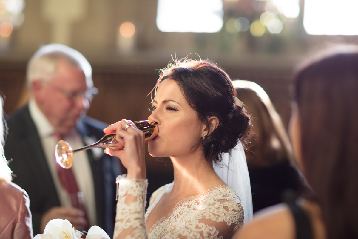 bride drinking at st audries park great hall