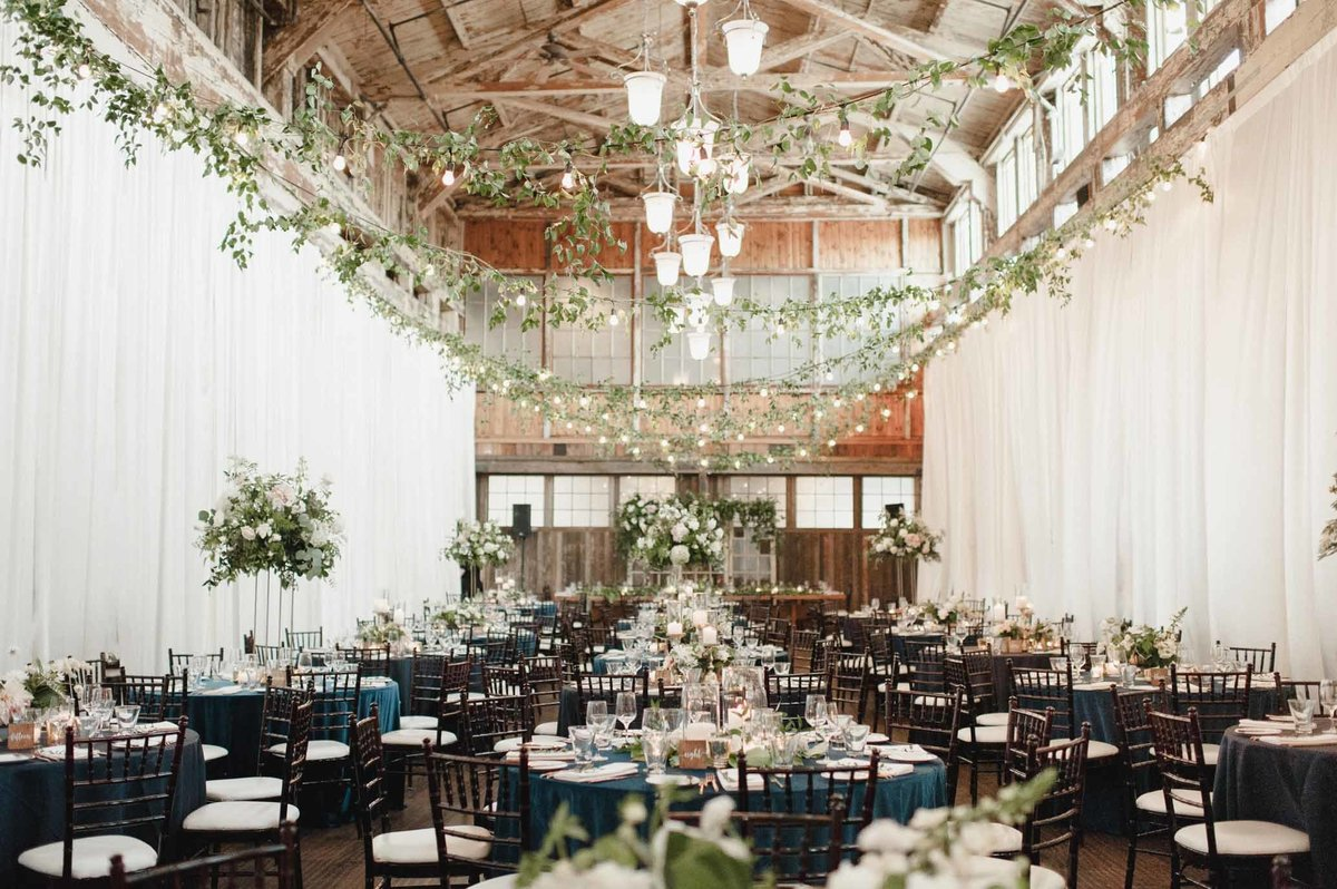 We love the look of the vines overhead softening this romantic wedding reception space.