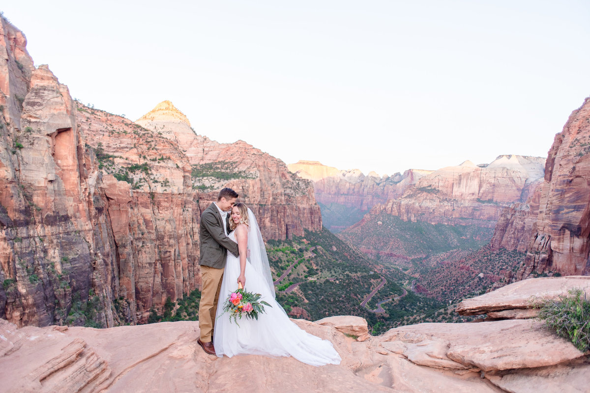 bride and groom hug at zion national park