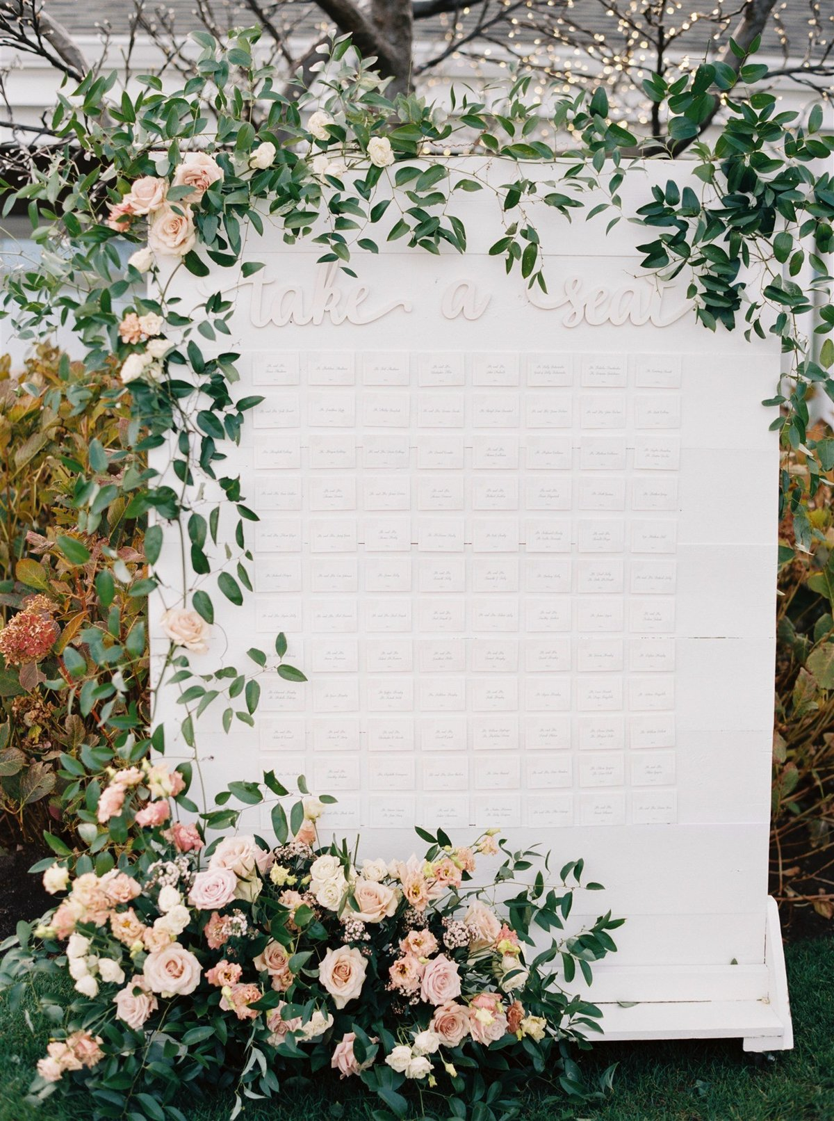 Unique escort card display and seating chart by creative wedding planner on Cape Cod