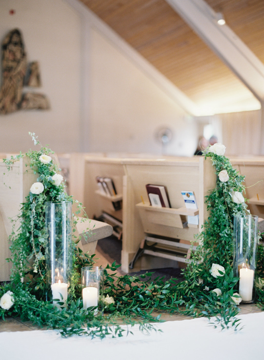 Church wedding ceremony pew greenery vines  and rose.
