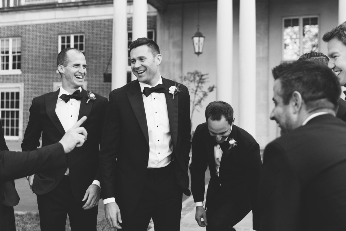 Groomsmen laugh in a real, candid moment captured by Atlanta's wedding photojournalist Rebecca Cerasani.
