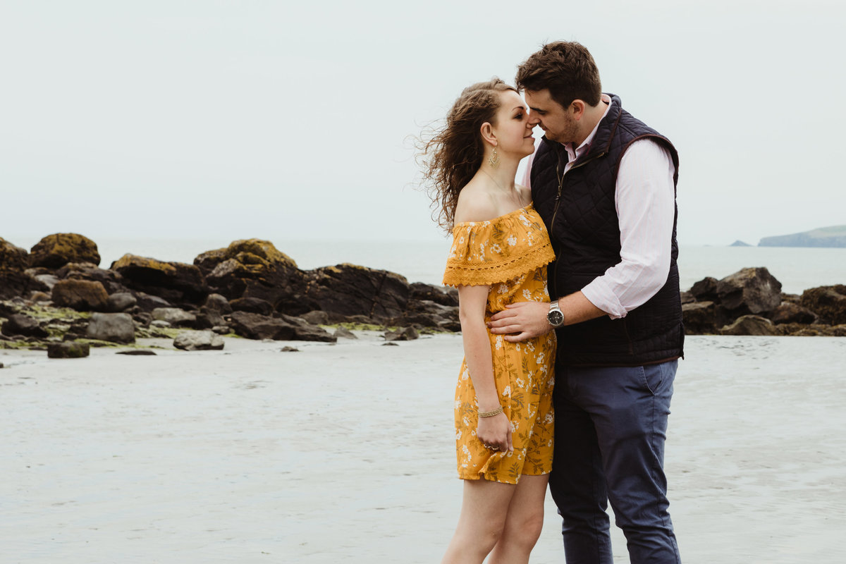 kissing engagement photograph at poppit beach