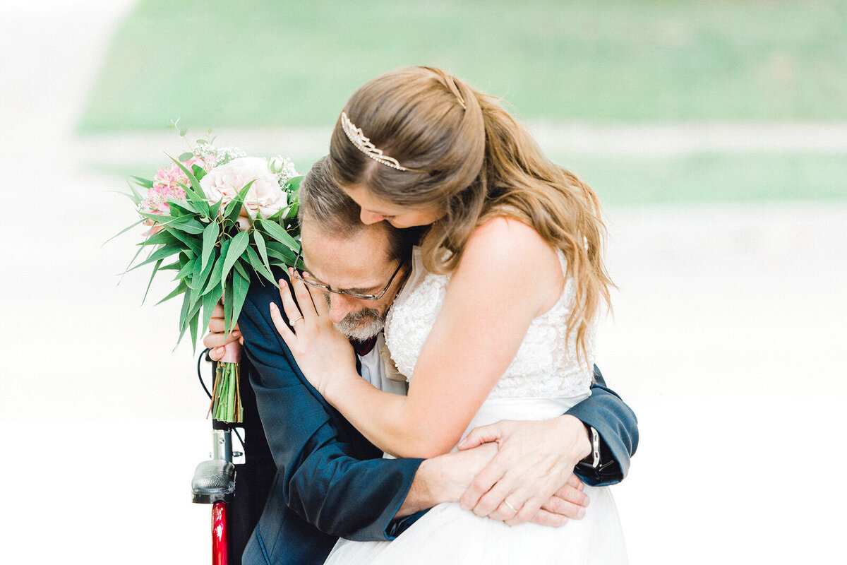 a bride hugs her dying father