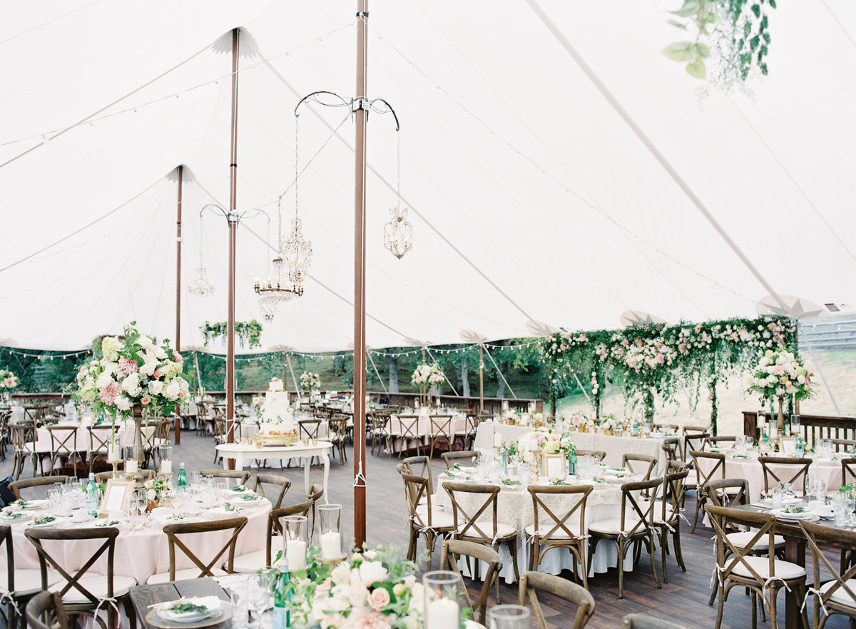 White tent in the garden of private residence in Seattle for wedding reception.