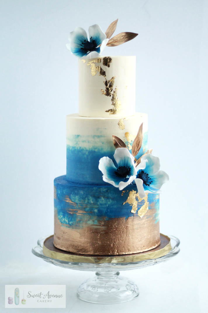 white, gold and navy blue watercolour buttercream wedding cake with sugar anemones