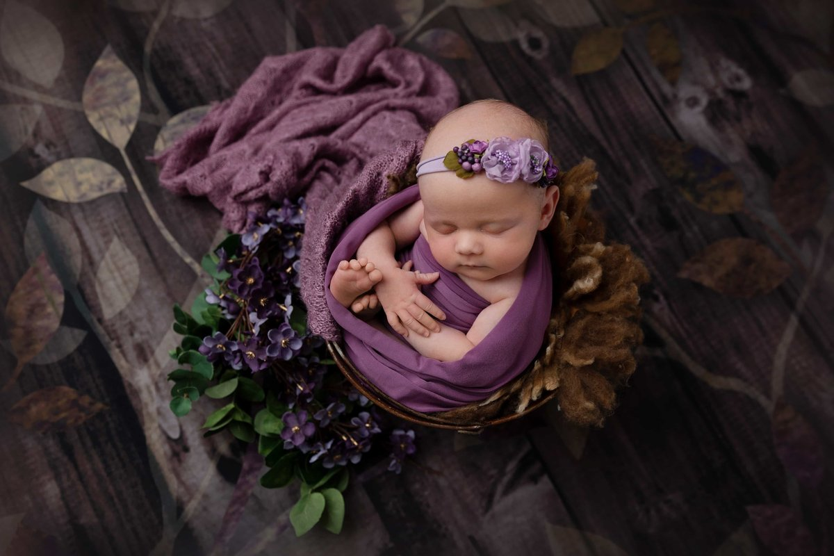 Wrapped in purple in a bucket