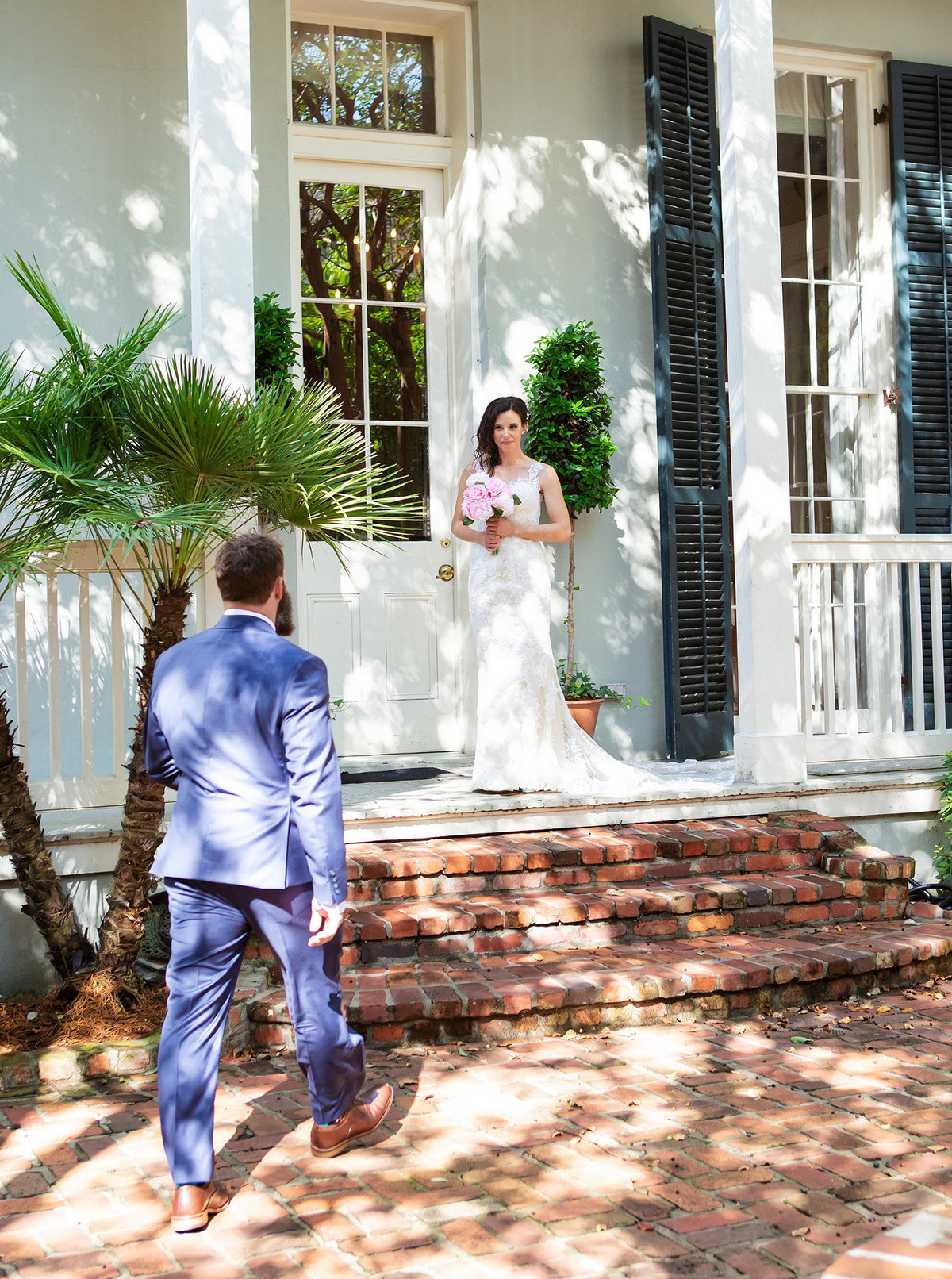 new orleans groom walking to bride at The Terrell House