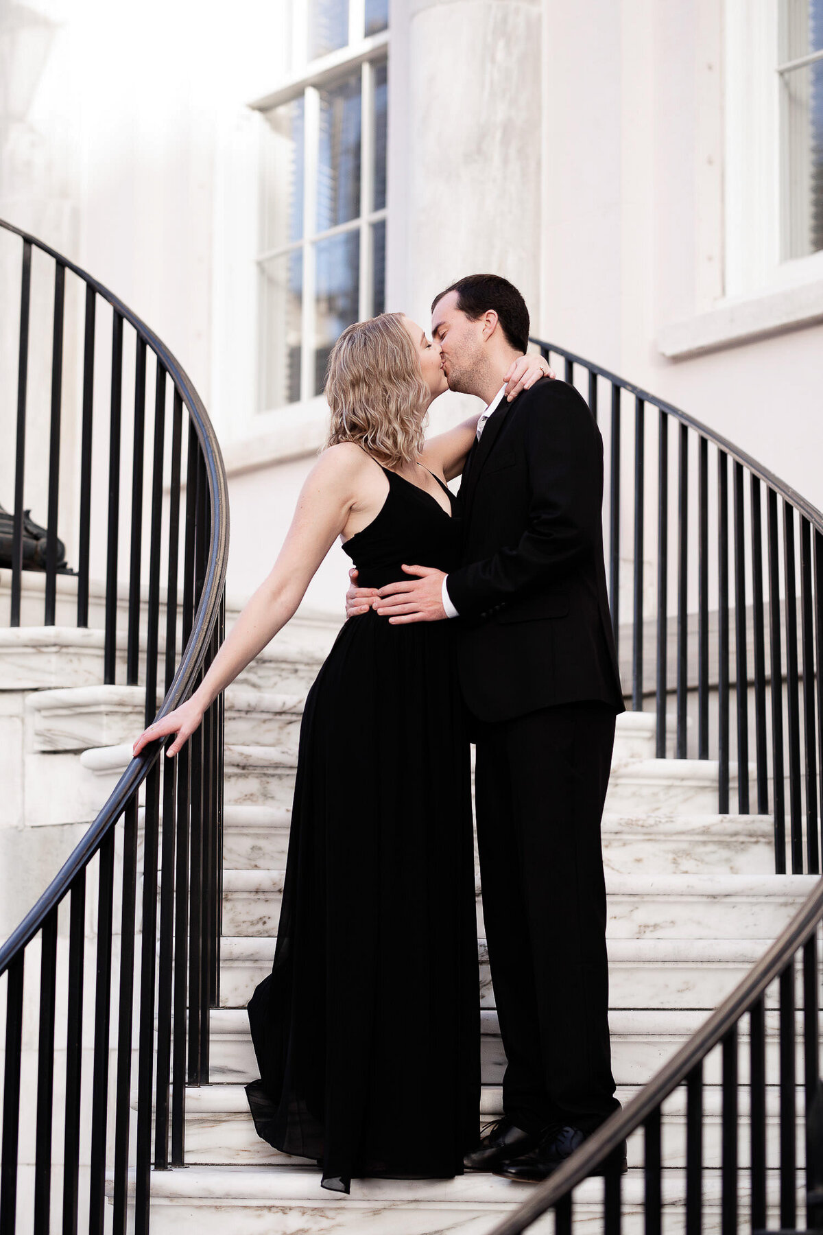 Charleston City Hall Couple kissing on stairs