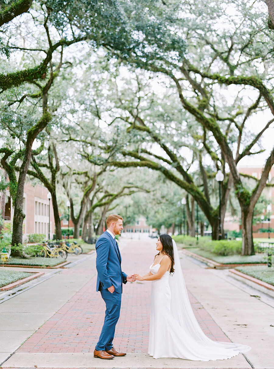 Bride & Groom under oak trees and Spanish moss