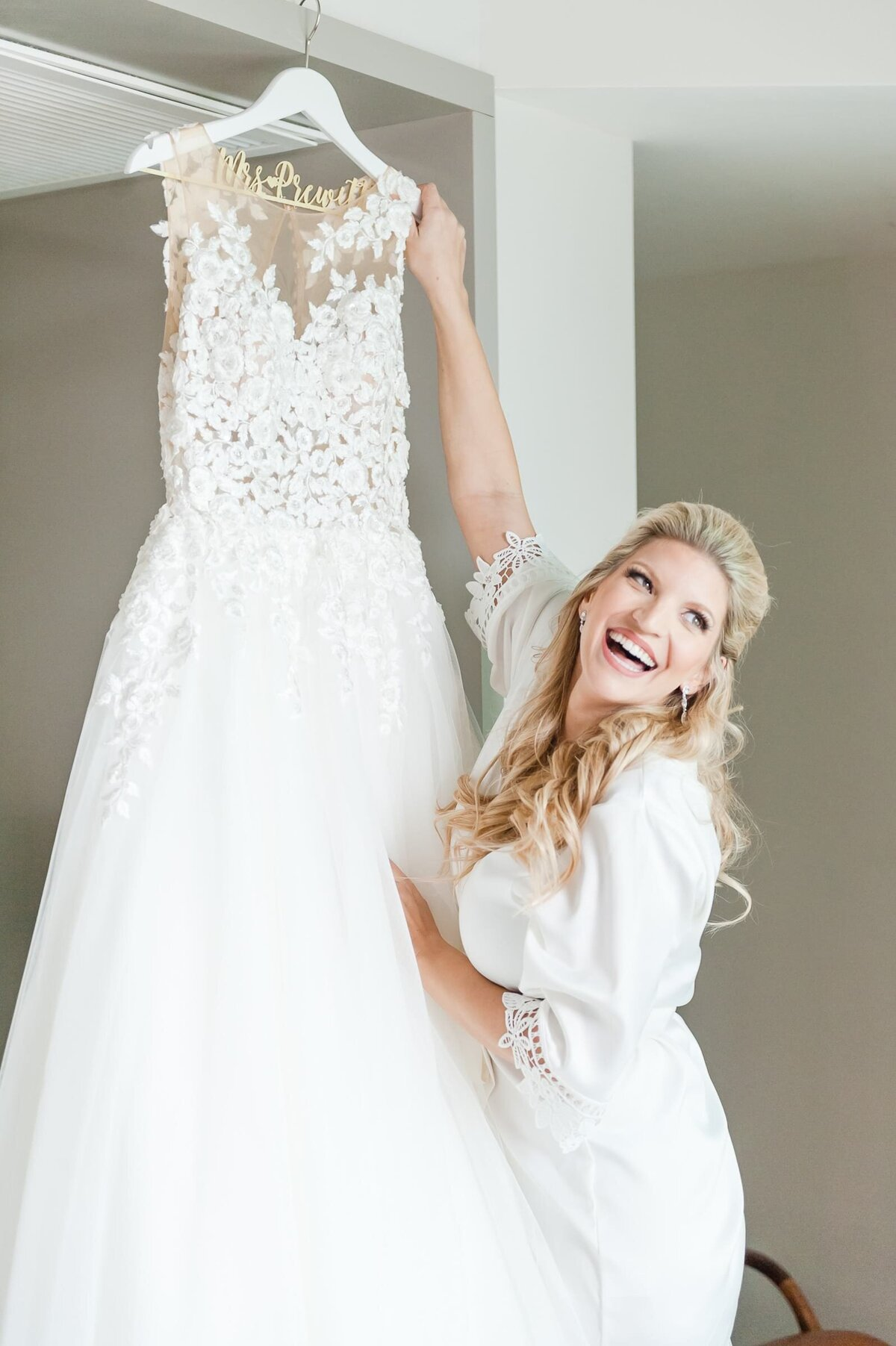 bride-laughing-with-bridal-gown