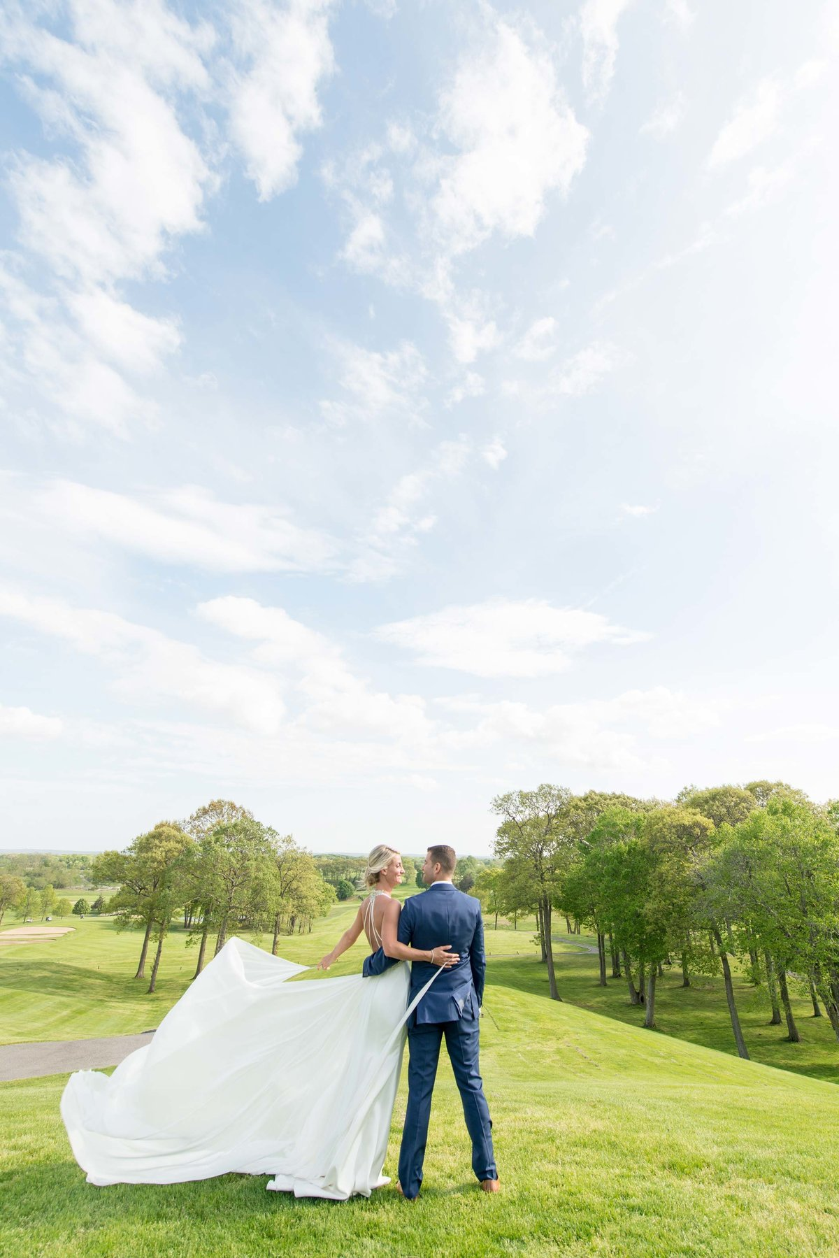 Golf view with bride and groom at Giorgio's Baiting Hollow