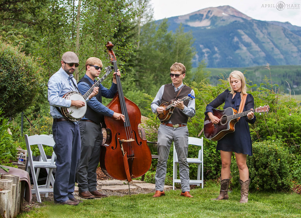 Bluegrass country band plays at outdoor Crested Butte Wedding ceremony at Mountain Wedding Garden in Colorado