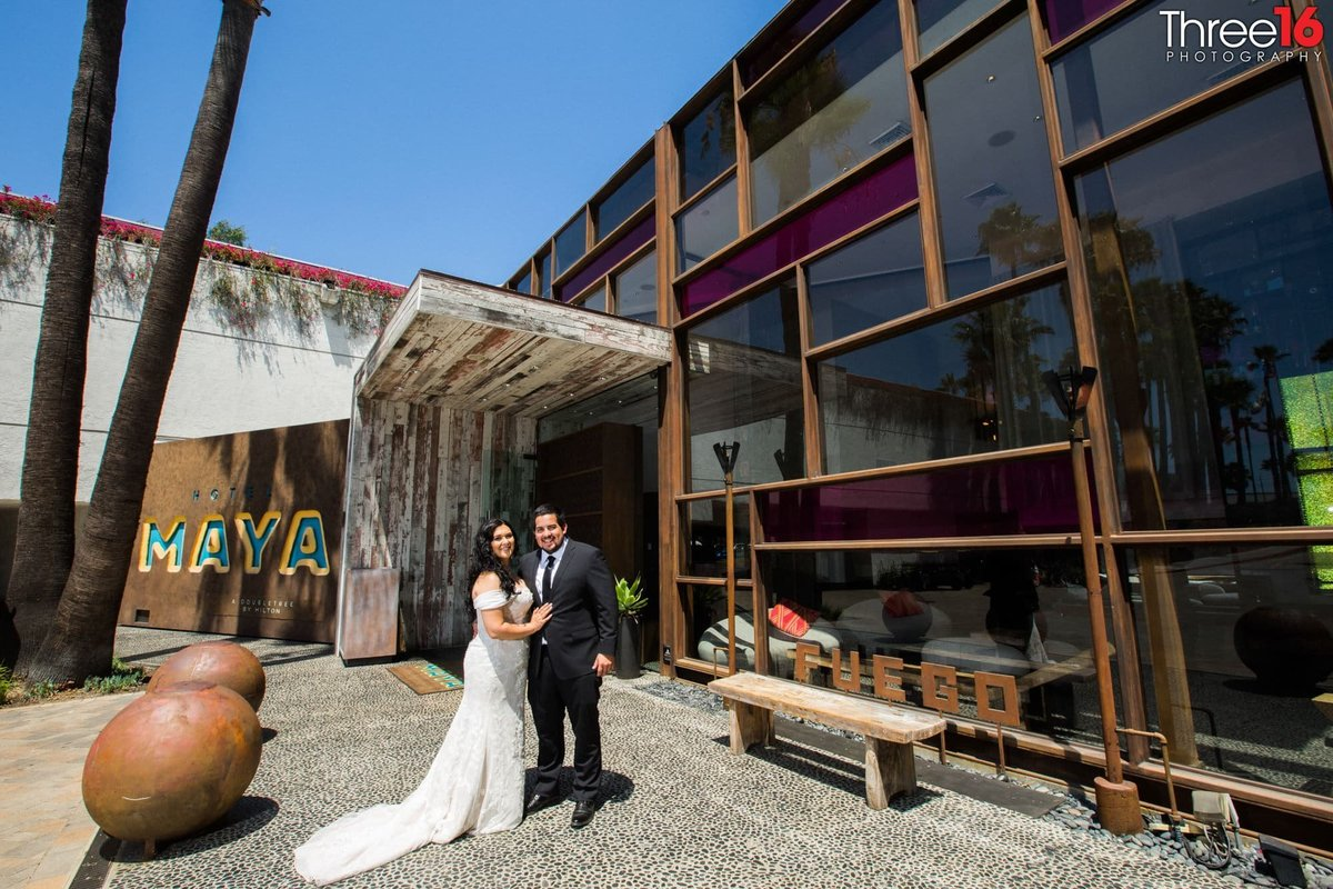 Bride and Groom outside the Hotel Maya wedding venue