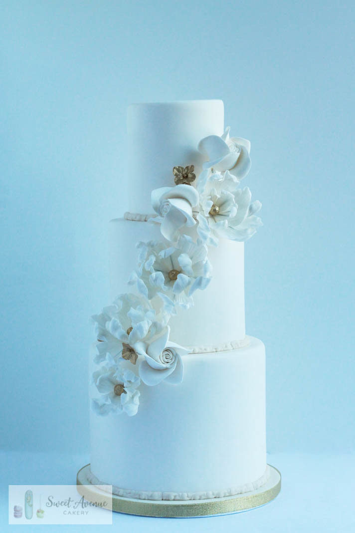 white wedding cake with flower cascade, Hamilton ON wedding cakes