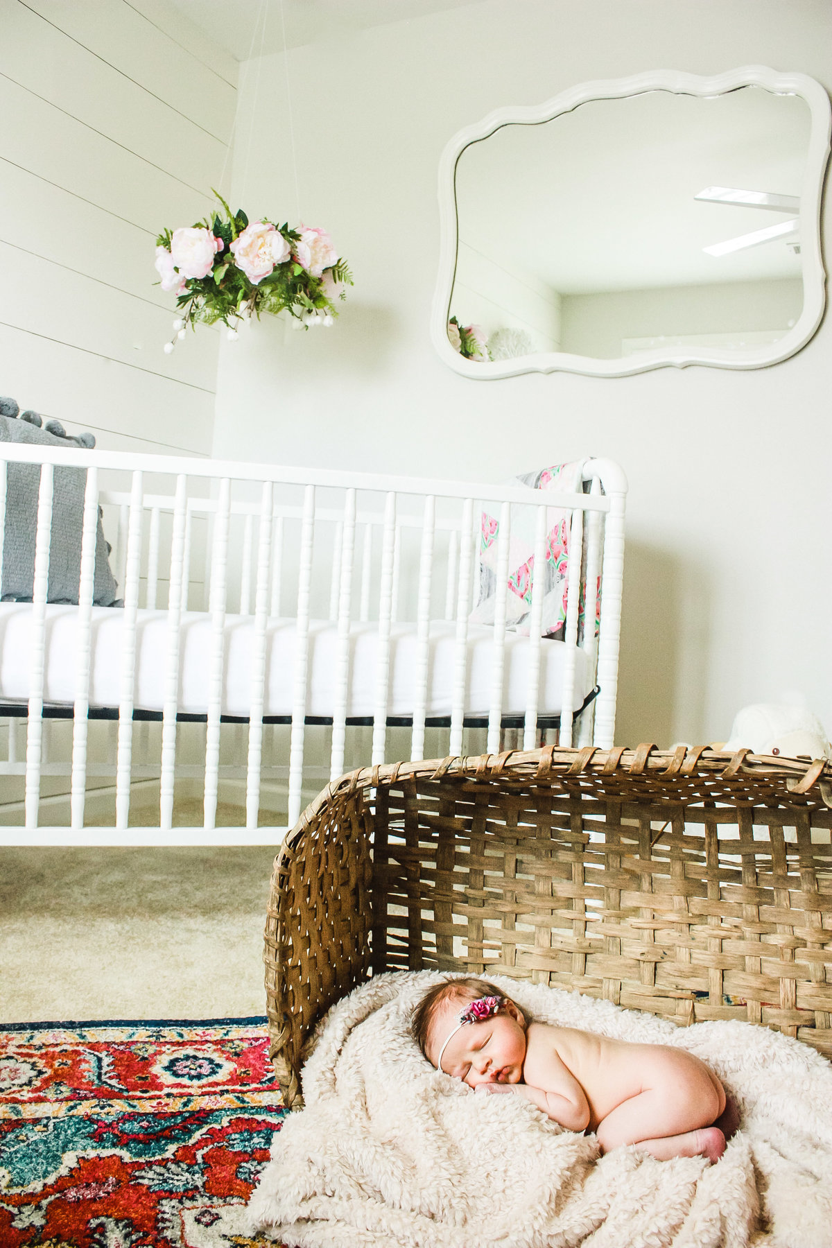 The nursery, baby in a basket, girl, newborn photography, in-home photoshoot