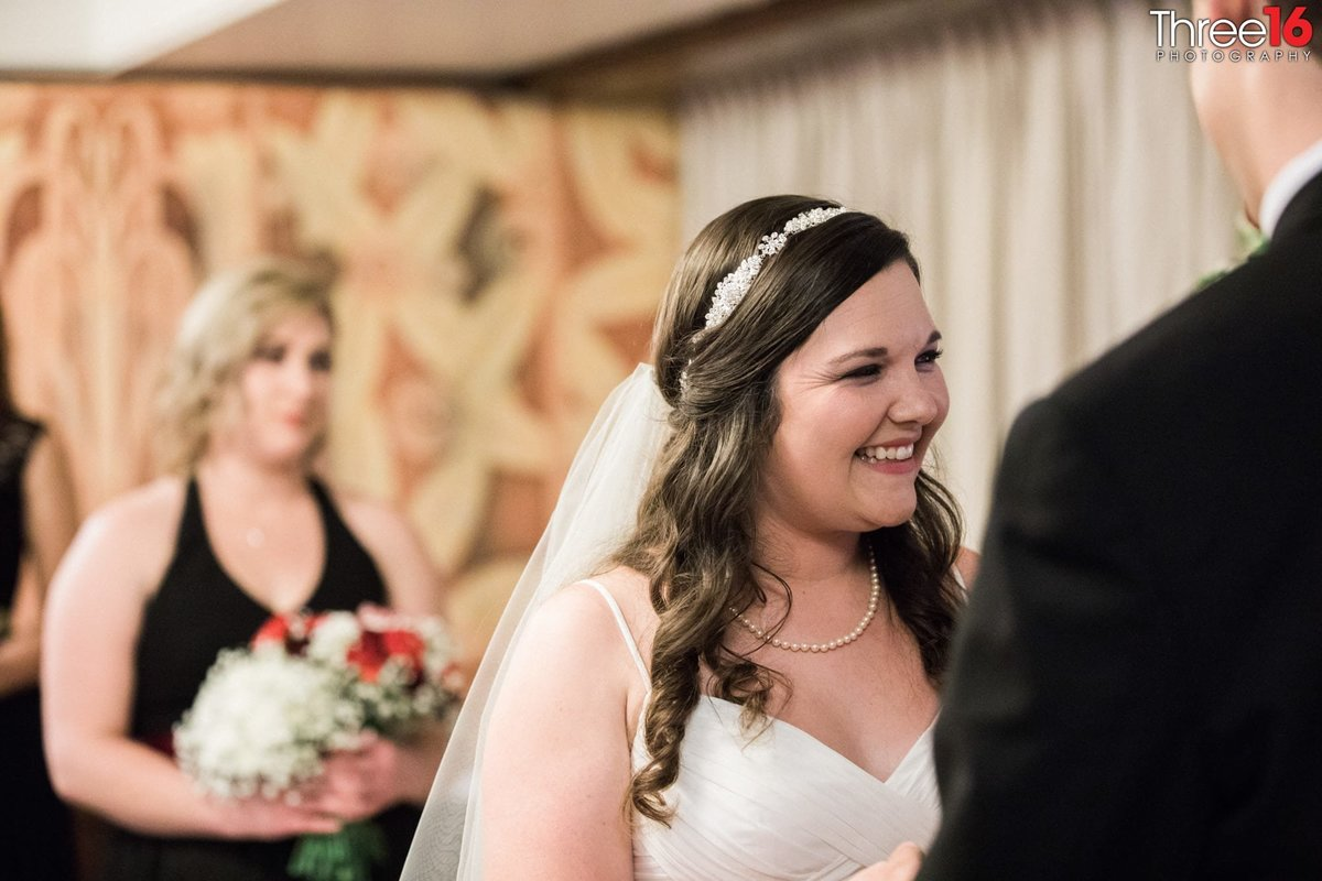 Bride smiles big during her wedding ceremony