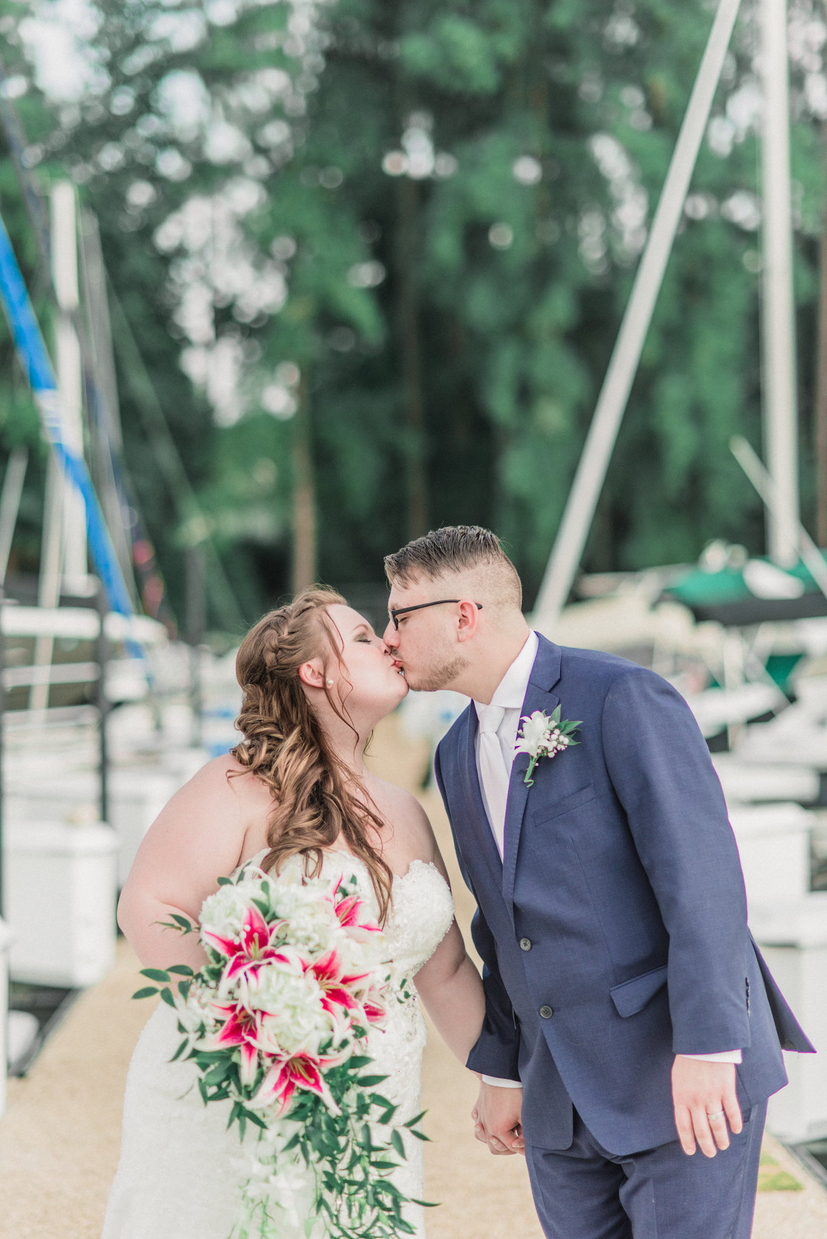 Bride and Groom Kiss Peninsula Yacht Club