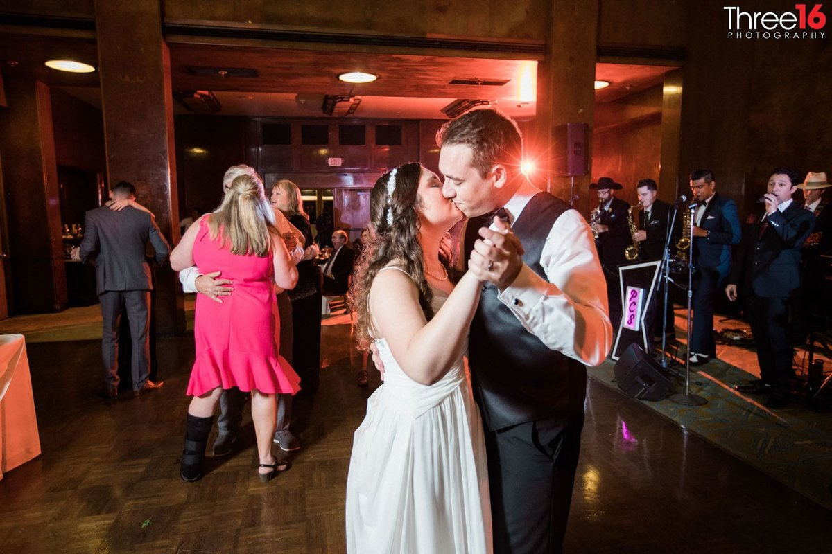 Bride and Groom share a kiss on the dance floor