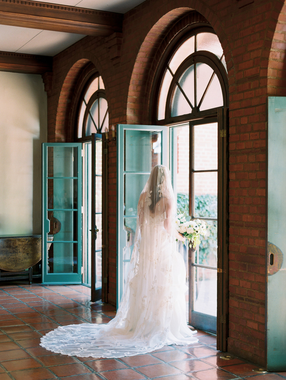 film wedding photo of a bride standing in a doorway