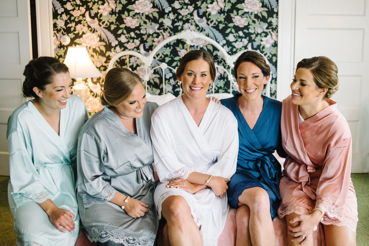 Bride and bridesmaids getting ready in robes