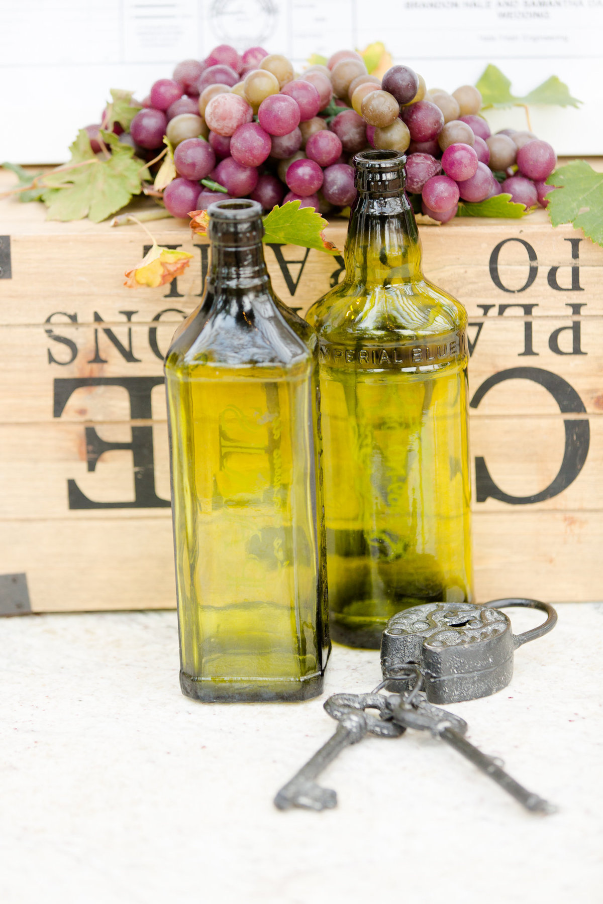 Grape and wine bottle details for a wedding reception at villa de amore by matty fran photography
