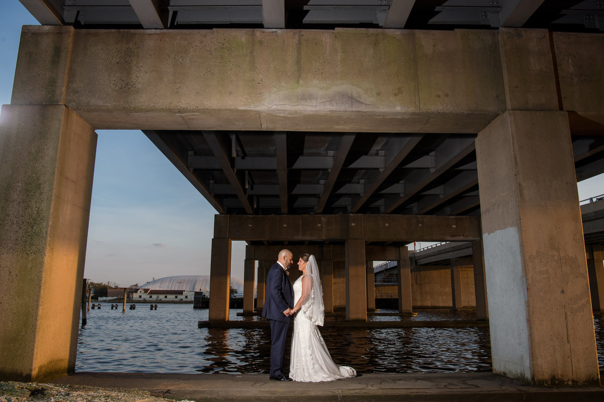 wedding photo of bride and groom outside under bridge at The Loft by Bridgeview