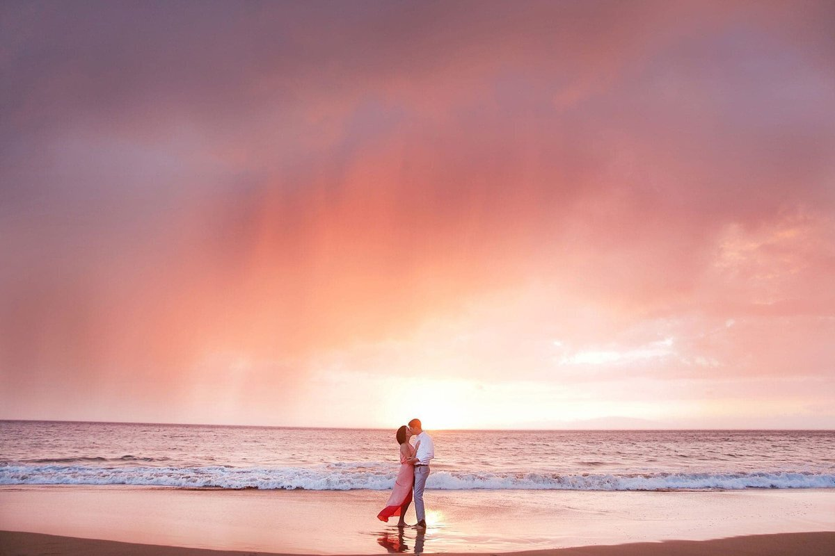 Dramatic Maui sunset portrait skies for engaged couple's beach session