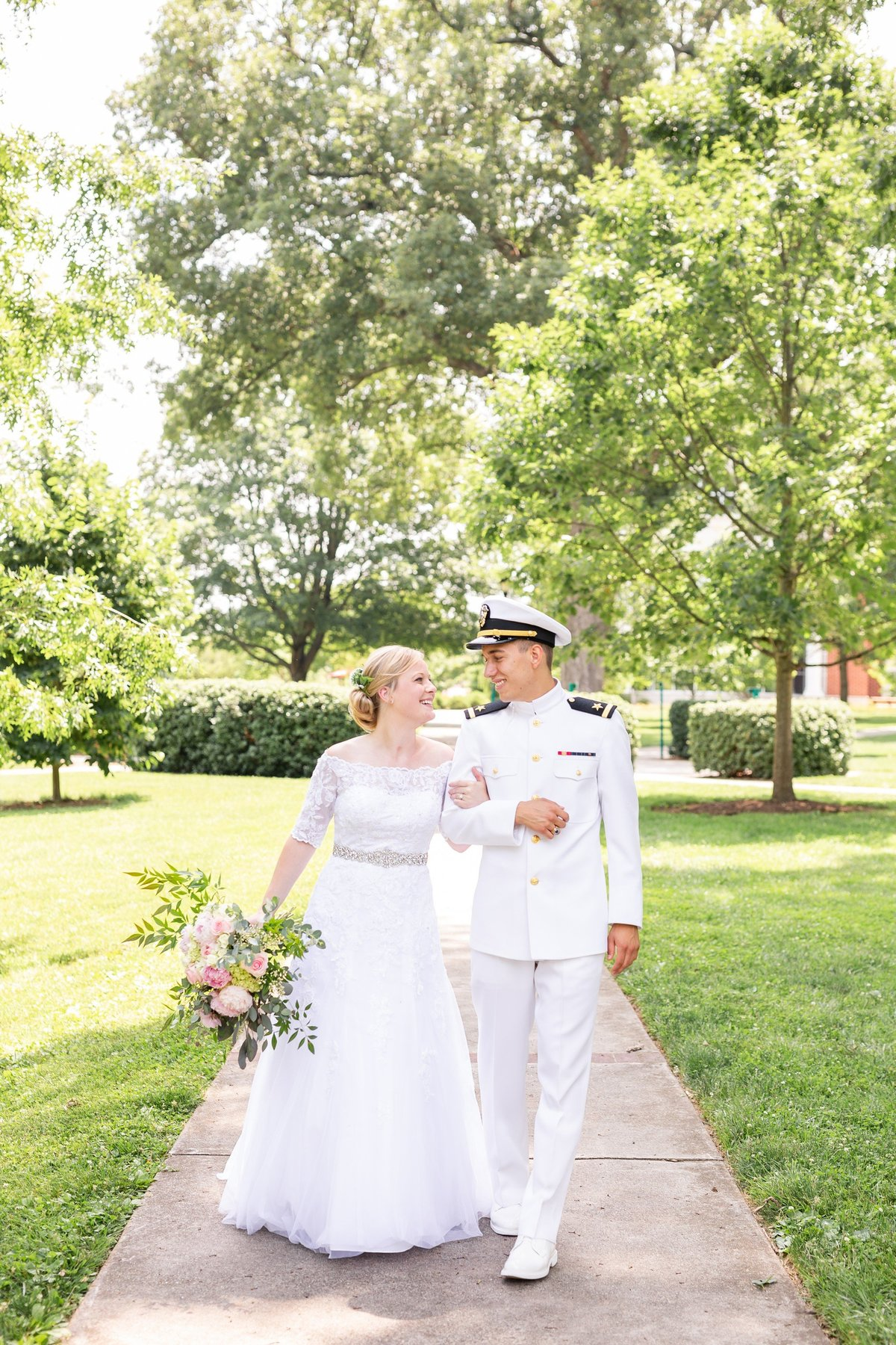 Jennifer Laura Photography wedding couple walking together in Lynchburg Virginia at Lynchburg College